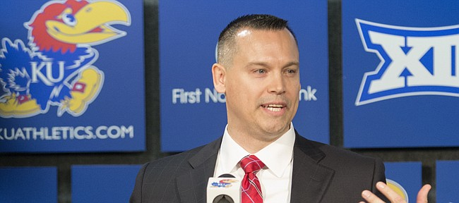 Brandon Schneider addresses reporters during his introduction Tuesday, April 21 as the new head coach of the KU women's basketball team.