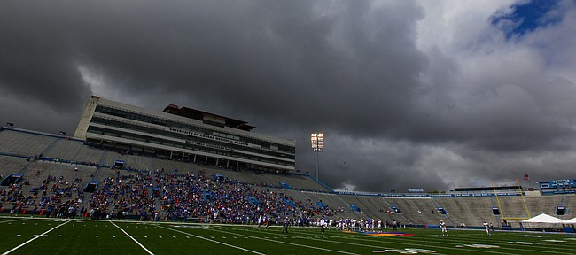Storm clouds hover over Memorial Stadium during the Spring Game on Saturday, April 25, 2015.
