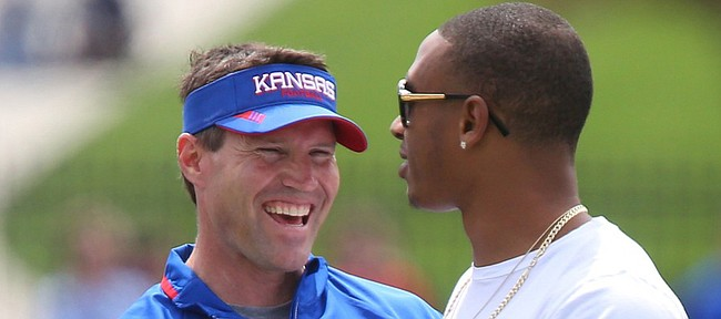 Kansas defensive coordinator Clint Bowen laughs with former player Bradley McDougald during the Spring Game on Saturday, April 25, 2015 at Memorial Stadium.