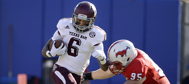 Texas A&M wide receiver LaQuvionte Gonzalez finds running room on a punt return as Texas A&M defensive lineman Julien Obioha (95) attempts the tackle in the second half of an NCAA college football game, Saturday, Sept. 20, 2014, in Dallas. Texas A&M won 58-6. (AP Photo/Tony Gutierrez)