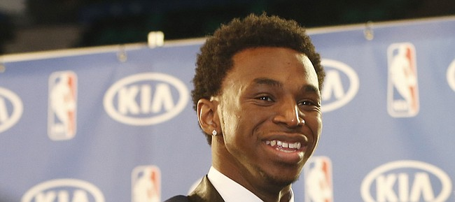 Minnesota Timberwolves' Andrew Wiggins holds his trophy at a news conference after he was named NBA basketball Rookie of the Year, Thursday, April 30, 2015, in Minneapolis. (AP Photo/Jim Mone)