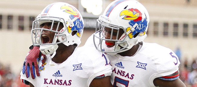 Kansas safety Isaiah Johnson (5) encourages teammate Dexter McDonald after McDonald bobbled a would-be interception against Texas Tech during the first quarter on Saturday, Oct. 18, 2014 at Jones AT&T Stadium in Lubbock, Texas. The Red Raiders scored on the ensuing drive.