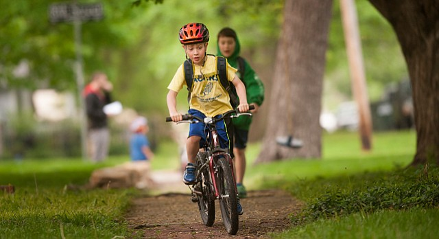 Ben Lyles, 6, a kindergarten student at Pinckney Elementary, was among those who biked to school Wednesday, May 6, 2015, on national Bike to School Day.