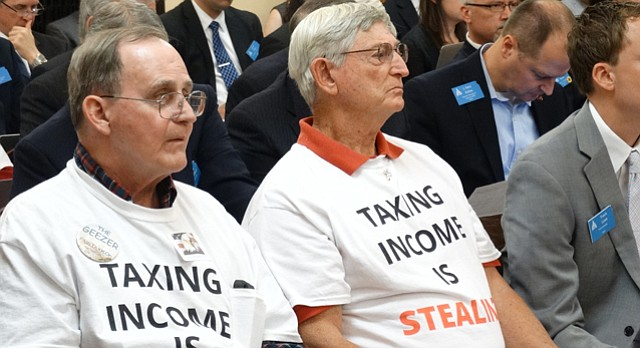A grassroots group calling itself the Kansas Eagles uses T-shirts to convey its message to House and Senate tax committees, Tuesday, May 19, 2015, at the Kansas Statehouse in Topeka.