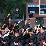 Members of the 2015 Lawrence High School graduating class toss their caps into the air at the end of the Commencement on Tuesday, May 19, 2015 at Lawrence High School.