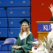 Hannah Reussner, left, listens to her classmate Sophie Westbrook speak during the Free State High School commencement Wednesday, May 20, 2015 at Allen Fieldhouse. Westbrook and Reussner both spoke on behalf of the graduating class.