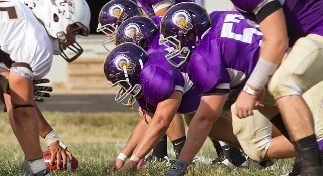 In this file photo from Oct. 8, 2011, the Haskell defensive line lines up across from Quincy University during a game at Haskell.