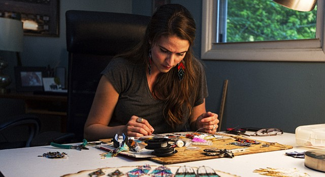 Jewelry designer Rachel Rieke, of Lawrence, works on pieces in her home studio on Thursday. Rieke's work will be shown in a tropical-themed, summertime collection at this Saturday's West 18th Street Fashion Show in Kansas City.