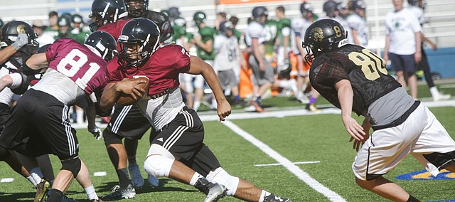 LHS's Alan Clothier (7) breaks loose against Topeka High on Tuesday, June 9, at KU's Memorial Stadium.