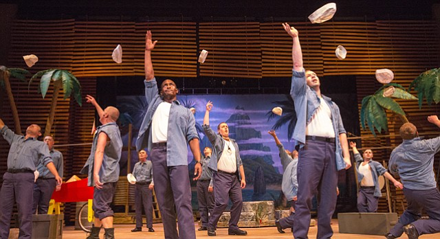 "Sailors toss their hats in the air as part of a dance routine during a dress rehearsal on Tuesday, June 9, for Theatre Lawrence's upcoming production of ""South Pacific."" The classic musical opens Friday and runs through June 28."
