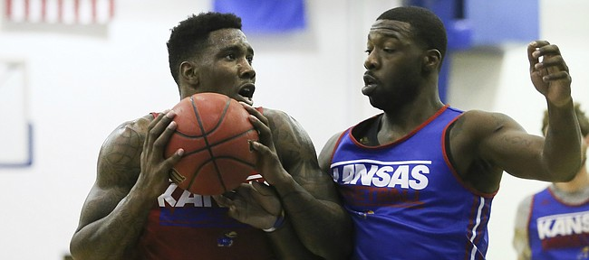Red Team player Jamari Traylor heads to the bucket against Blue Team player Elijah Johnson during a scrimmage, Wednesday, June 10, 2015 at the Horejsi Family Athletic Center.