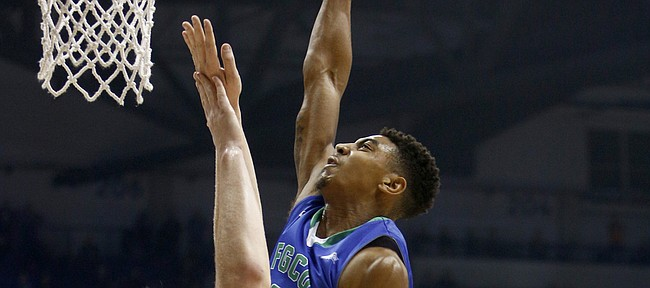 Florida Gulf Coast guard Julian DeBose (3) shoots against Xavier center Matt Stainbrook (40) in the second half of an NCAA college basketball game, Sunday, Dec. 28, 2014, in Cincinnati. Xavier won 71-57. (AP Photo/David Kohl)