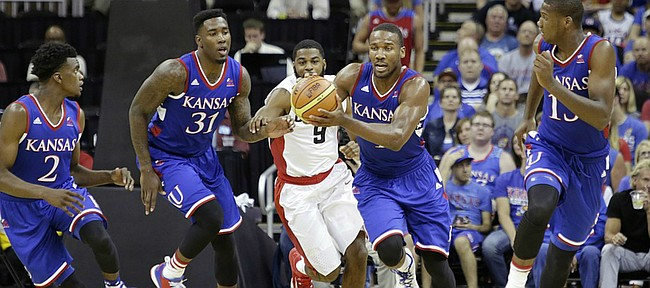 Kansas guard Wayne Selden Jr. (1) starts a fast break with teammates from left, LaGerald Vick (2), Jamari Traylor (31) Selden and Carlton Bragg (15) during a 91-83 Team USA exhibition game win against Canada Tuesday, June 23, at the Sprint Center in K.C., MO.