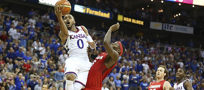 Kansas guard Frank Mason III (0) is fouled on the way to the bucket by Team Canada guard Mamadou Gueye during the third quarter of Friday's World University Games exhibition at Sprint Center.