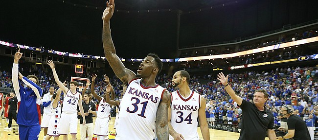 Kansas forward Jamari Traylor (31) and his teammates and coaches wave to the Jayhawk fans following the Jayhawks' 87-76 win over Team Canada in Friday's World University Games exhibition at Sprint Center.
