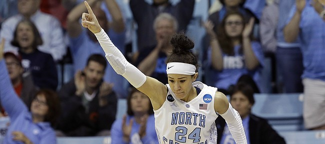 North Carolina's Jessica Washington (24) reacts following a basket against Liberty during the first half of a women's college basketball game in the first round of the NCAA tournament in Chapel Hill, N.C., Saturday, March 21, 2015. North Carolina won 71-65. (AP Photo/Gerry Broome)