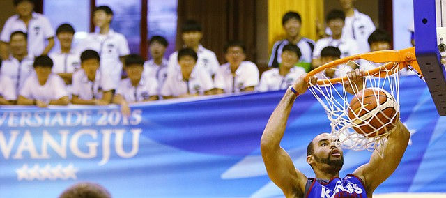 Kansas forward Perry Ellis dunks as Gwangju High School students watch from a balcony during a Team USA practice at the school Tuesday, June 30. The Team USA/Jayhawks will play an exhibition game against China here Thursday, July 2.