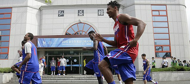Team USA guard Julian DeBose, foreground right, and other team members warm up outside before a team practice at Gwangju High School Wed., July 1. Team USA will play an exhibition game against China on Thursday, July 2.