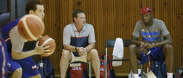 Kansas coach Bill Self, left, and Carlton Bragg visit before  a Team USA 93-56 scrimmage game win over China Thursday, July 2. Bragg, who has a broken nose, did not play.