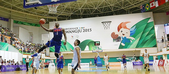Kansas guard Wayne Selden Jr. (1) drives to the basket in a 106-41 Team USA win against Chile Tuesday, July 7, at the World University Games in South Korea.