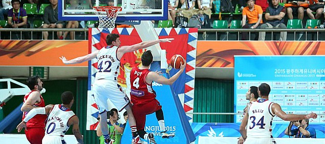 Kansas center Hunter Mickelson (42) reaches to block a shot by Serbia guard Stefan Pot (4) in a Team USA 66-65 win against Serbia Wednesday, July 8, at the World University Games in South Korea.