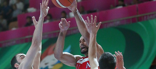 Kansas forward Perry Ellis  (34) passes out from beneath the basket in a Team USA game against Serbia Wednesday, July 8, at the World University Games in South Korea.