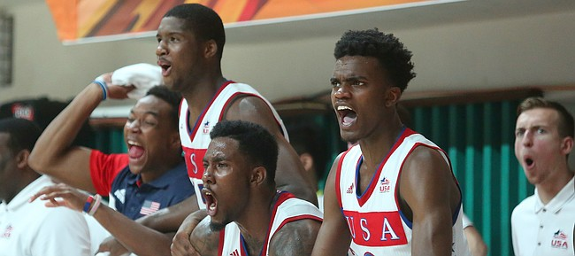The Team USA bench celebrates a slam dunk by Kansas guard Wayne Selden Jr. in a Team USA 96-57 win over Switzerland Thursday, July 9, at the World University Games in South Korea.