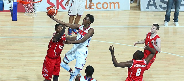 Kansas guard Lagerald Vick (2) drives to the basket in a Team USA game against Switzerland Thursday, July 9, at the World University Games in South Korea.