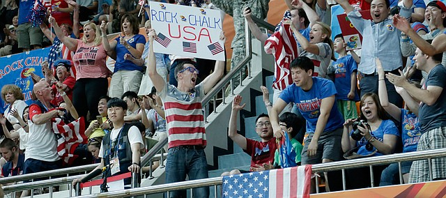 Kansas Jayhawk fans celebrate Team USA's 66-57 win against Turkey Saturday, July 4, in Gwangju, South Korea.