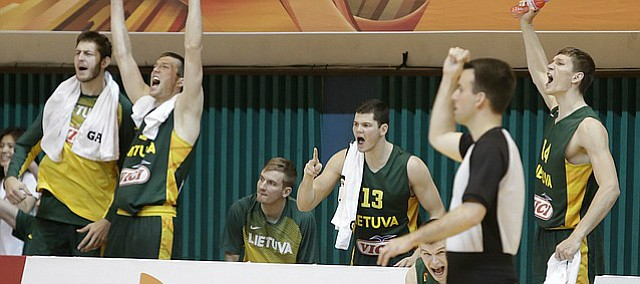 The Lithuanian team bench celebrates a late basket in the teams 74-67 win over Australia. Lithuania will play Team USA in the quarterfinals at noon Saturday in Gwangju, South Korea (10 p.m. Friday CDT). Friday's game will be broadcast by ESPNU.