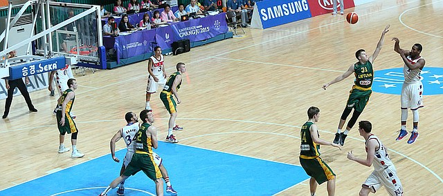 Kansas guard Wayne Selden Jr. (1) passes inside to Kansas forward Perry Ellis (34) who scored on the play in the first-half  of Team USA's quarter-final game against Lithuania Saturday, July 11, at the World University Games in Gwangju, South Korea.
