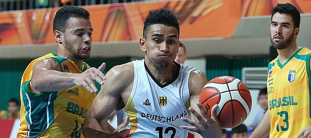 German guard Maodo Lo (12) drives to the basket in a German semi-final win against Brazil Sunday, July 12, at the World University Games in South Korea.