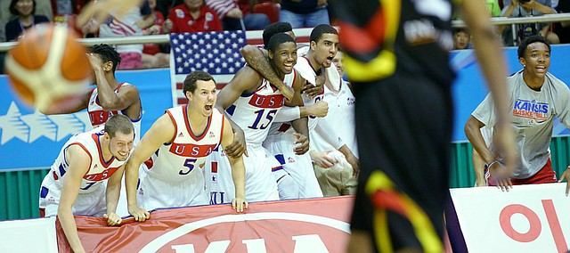 The Team USA bench celebrates a late three-point basket by Wayne Selden Jr. in a Team USA double-overtime win against Germany Monday, July 13, at the World University Games in South Korea.