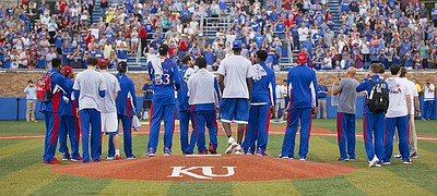 Members of the Kansas University basketball team, who won a gold medal representing Team USA during the recent World University games in South Korea are given a standing ovation as they are welcomed home during a ceremony Wednesday, July 15, 2015 at Hoglund Ballpark.