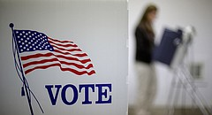 Ruth Meier, from Silver Lake, Kan, votes at the Prairie Home Cemetery building, Tuesday, Nov. 4, 2014, in Topeka, Kan. (AP Photo/Charlie Riedel)