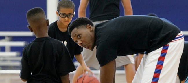 Miami Heat and former KU basketball player Mario Chalmers works with youth at his basketball camp Monday, July 20, at the Sports Pavilion Lawrence.