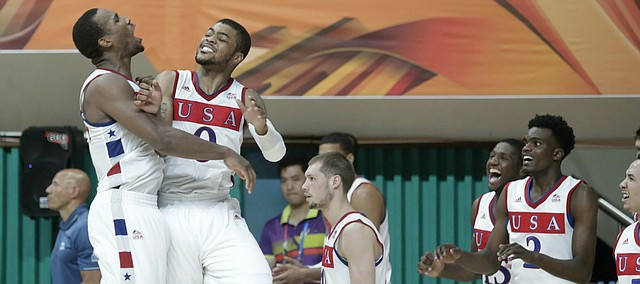 Kansas guard Wayne Selden Jr. (1) and Frank Mason III (0) celebrate a Team USA 66-65 win against Serbia Wednesday, July 8, at the World University Games in South Korea.