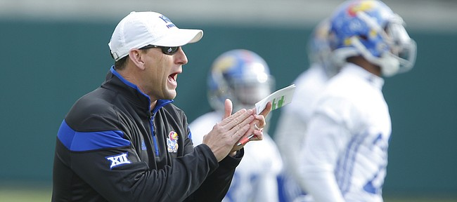 Kansas head coach David Beaty tries to keep his team amped up during spring practice on Tuesday, March 24, 2015.