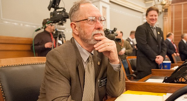 Rep. Tom Sloan, R-Lawrence, watches as Gov. Sam Brownback delivers his State of the State address at the Kansas State Capital on Thursday, Jan. 15, 2015.