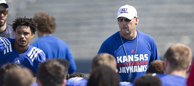 Kansas football coach David Beaty talks to his team during a break on Friday, Aug. 21, 2015.