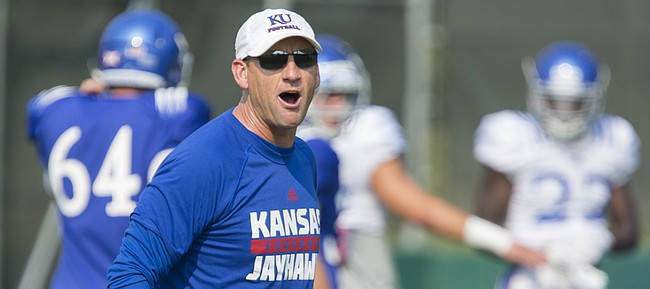 Kansas University football coach David Beaty gives a directive to his players from across the field during practice on Wednesday, Aug. 26, 2015.
