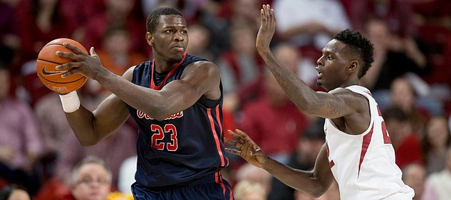 Mississippi center Dwight Coleby, left, looks to pass as he's defended by Arkansas forward Jacorey Williams in this photo from Jan. 17 in Fayetteville, Arkansas.