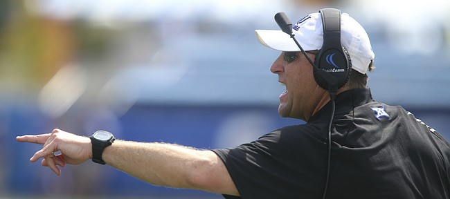Kansas head coach David Beaty screams at his players during the third quarter on Saturday, Sept. 5, 2015 at Memorial Stadium.