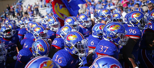 The Jayhawks pack it in tight as they prepare to rush onto the field before kickoff on Saturday, Sept. 5, 2015 at Memorial Stadium.