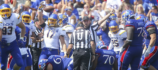 The Jackrabbits celebrate after recovering a fumble by Kansas quarterback Montell Cozart during the second quarter on Saturday, Sept. 5, 2015 at Memorial Stadium.