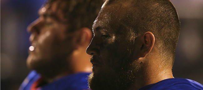 Kansas offensive lineman Jordan Shelley-Smith (79) sits on the sidelines during the Jayhawks' 55-23 loss to Memphis on Saturday, Sept. 12, 2015 at Memorial Stadium.