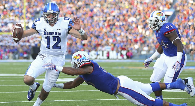Kansas defensive end Ben Goodman (10) dives to force Memphis quarterback Paxton Lynch (12) out of bounds during the second quarter on Saturday, Sept. 12, 2015 at Memorial Stadium. At right is Kansas defensive tackle Tyler Holmes (94).