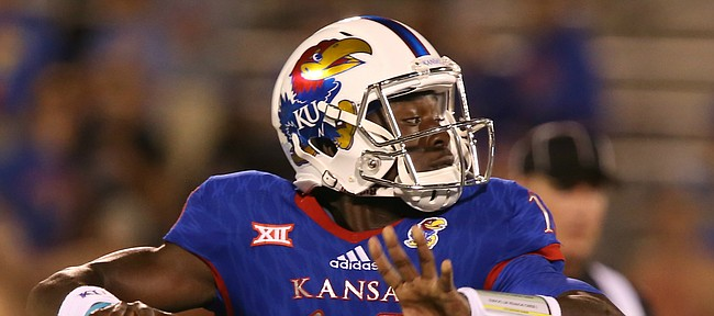 Kansas quarterback Deondre Ford (15) drops back to pass during the fourth quarter on Saturday, Sept. 12, 2015 at Memorial Stadium.