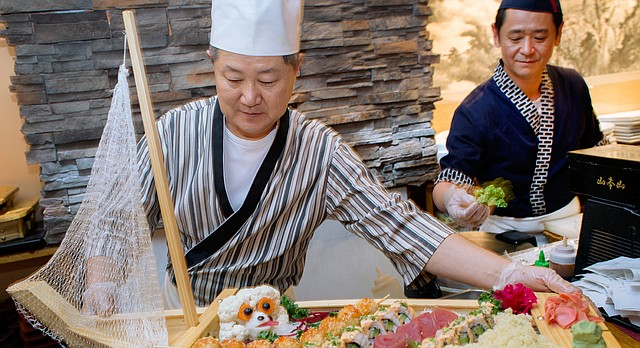 Chef James Koh, left, and executive chef Jay Chi prepare some sushi dishes for customers Saturday at Wa Japanese Restaurant, 740 Massachusetts St. Wa will be one of several participants in the second annual Downtown Lawrence Restaurant Week