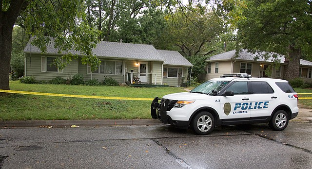 Lawrence police stand by a home in the 2100 block of Carolina Street around 9:30 a.m. Friday, Sept. 18, 2015. Police were investigating a shooting that was reported around 4:30 a.m.